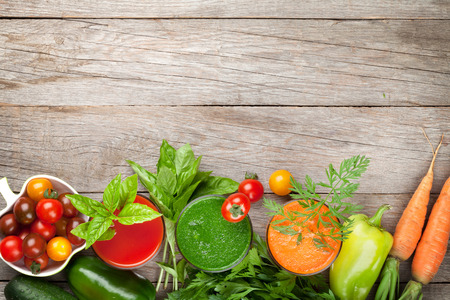 Photo for Fresh vegetable smoothie on wooden table. Tomato, cucumber, carrot. Top view with copy space - Royalty Free Image