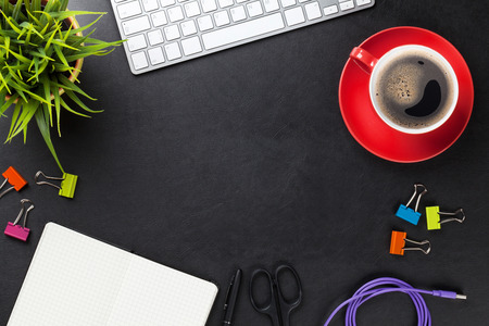 Foto de Office leather desk table with computer, supplies, coffee cup and flower. Top view with copy space - Imagen libre de derechos