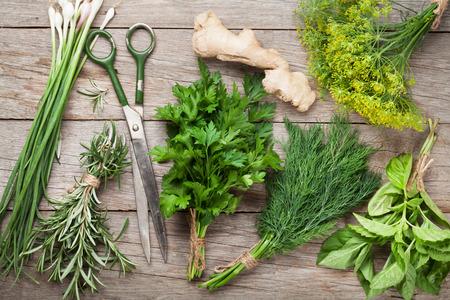 Photo pour Fresh garden herbs on wooden table. Top view - image libre de droit