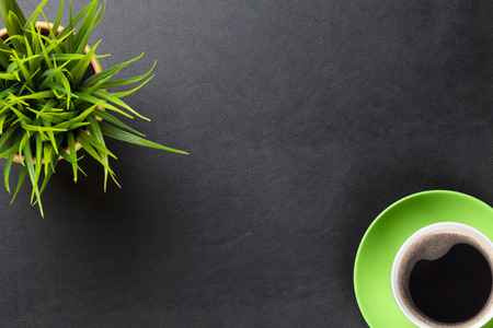 Photo for Office leather desk table with flower and coffee cup. Top view with copy space - Royalty Free Image
