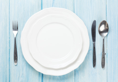 Photo for Empty plate and silverware over wooden table background. View from above with copy space - Royalty Free Image