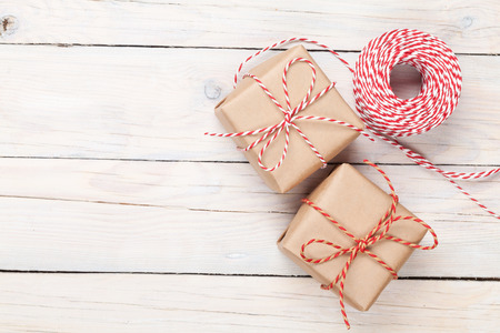 Gift wrapping over white wooden table with copy space