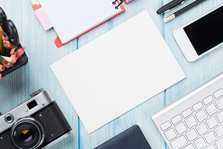 Photo for Office desk with supplies, camera and blank card. Top view with copy space - Royalty Free Image