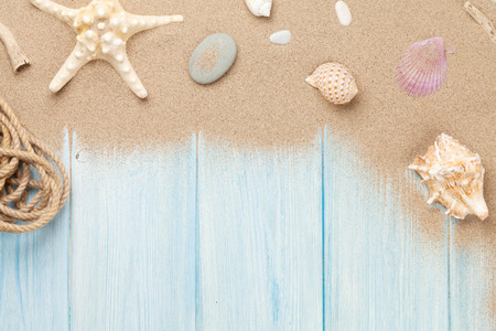 Photo for Sea sand with starfish and shells on wooden table. Top view with copy space - Royalty Free Image