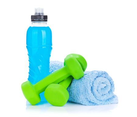 Foto de Two green dumbells, towel and water bottle. Fitness and health. Isolated on white background - Imagen libre de derechos