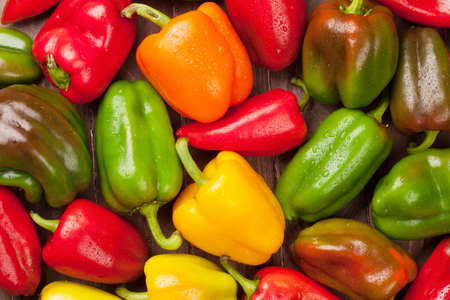 Photo for Fresh colorful bell peppers on wooden table. Top view - Royalty Free Image
