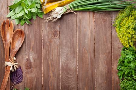 Photo pour Fresh garden herbs on wooden table. Top view with copy space - image libre de droit