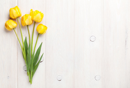 Photo pour Yellow tulips over wooden table background with copy space - image libre de droit