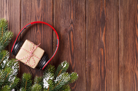 Photo for Christmas gift box with headphones and tree branch. Top view with copy space - Royalty Free Image
