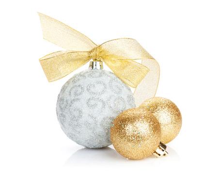 Foto de Christmas baubles and golden ribbon. Isolated on white background - Imagen libre de derechos
