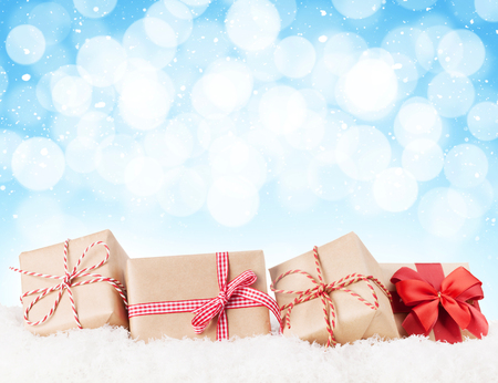 Photo for Christmas gift boxes in snow with bokeh background for copy space - Royalty Free Image