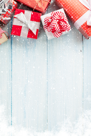 Photo for Christmas gift boxes on wooden table with snow. Top view with copy space - Royalty Free Image