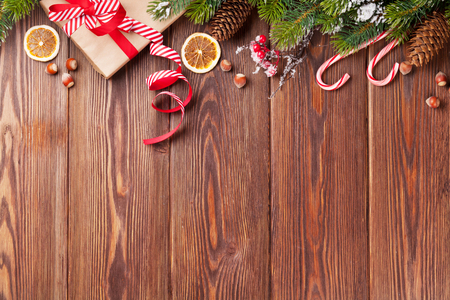 Photo pour Christmas gift box, food decor and fir tree branch on wooden table. Top view with copy space - image libre de droit