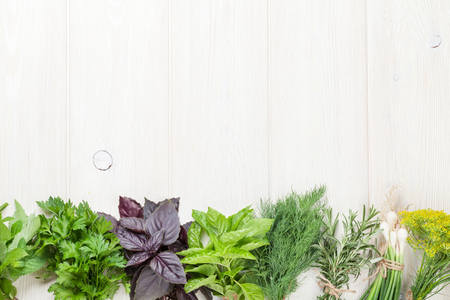 Foto de Fresh garden herbs on wooden table. Top view with copy space - Imagen libre de derechos