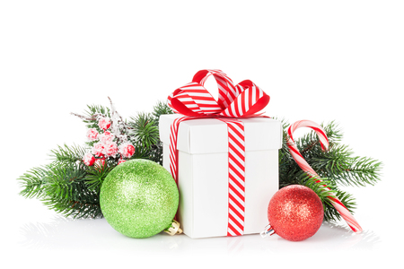 Foto de Christmas gift box, baubles and candy cane. Isolated on white background - Imagen libre de derechos