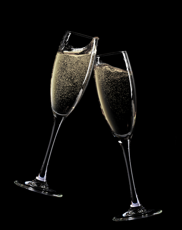 Photo for Cheers! Two champagne glasses. Isolated on black background - Royalty Free Image