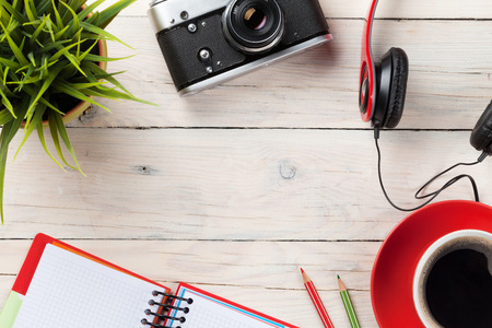 Photo pour Set of travel stuff. Camera, headphones, notepad and coffee cup on wooden table. Top view with copy space - image libre de droit