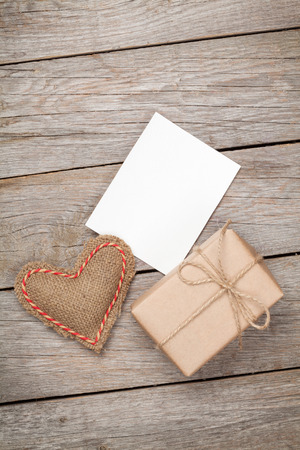 Photo for Valentines day toy heart, blank greeting card and gift box over wooden table background - Royalty Free Image