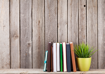 Photo for Wooden shelf with books in front of wooden wall. View with copy space - Royalty Free Image