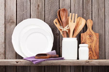 Photo for Kitchen cooking utensils on shelf against rustic wooden wall - Royalty Free Image