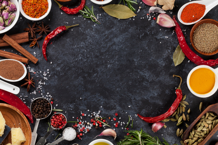 Photo pour Herbs, condiments and spices on stone background. Top view with copy space - image libre de droit