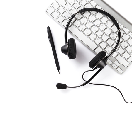 Photo pour Headset, pen and keyboard. Call center support. Isolated on white background - image libre de droit