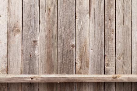Foto de Wood shelf in front of wooden wall. View with copy space - Imagen libre de derechos