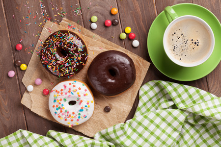 Photo for Donuts and coffee on wooden table. Top view - Royalty Free Image