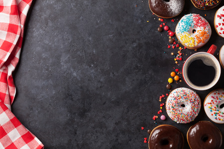 Photo for Donuts and coffee on stone table. Top view with copy space - Royalty Free Image