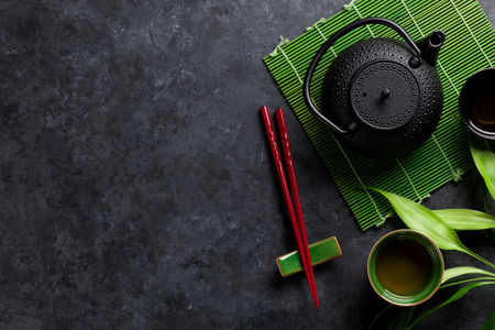 Photo for Green tea and sushi chopsticks on stone table. Top view with copy space - Royalty Free Image