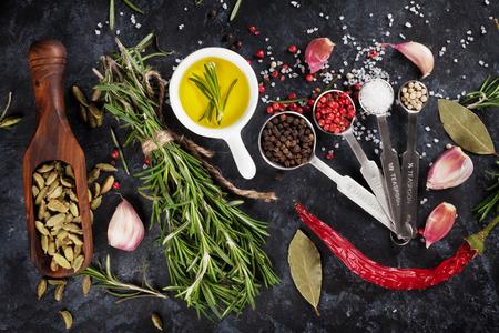Photo pour Herbs and spices over black stone background. Top view - image libre de droit