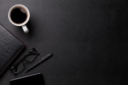 Photo for Office leather desk table with coffee and supplies. Top view with copy space - Royalty Free Image