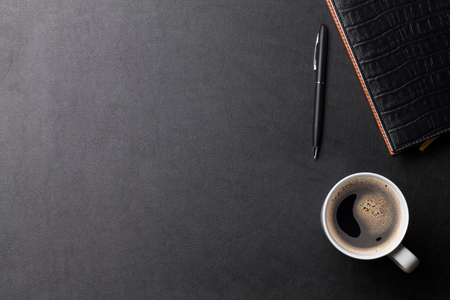 Photo pour Office leather desk table with coffee and supplies. Top view with copy space - image libre de droit