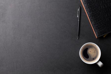 Foto de Office leather desk table with coffee and supplies. Top view with copy space - Imagen libre de derechos