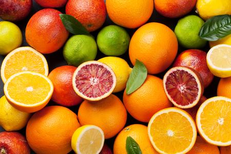 Photo pour Fresh citruses. Oranges, lemons and limes. Top view - image libre de droit