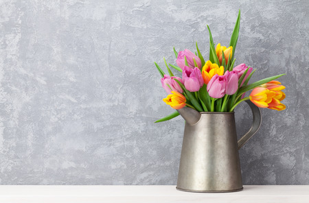 Photo for Fresh colorful tulip flowers bouquet in front of stone wall. View with copy space - Royalty Free Image