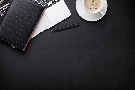 Photo pour Office leather desk workplace table with laptop, coffee cup, notepad and pen. Top view with copy space - image libre de droit
