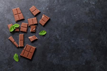 Foto de Chocolate on dark stone background. Top view with copy space - Imagen libre de derechos