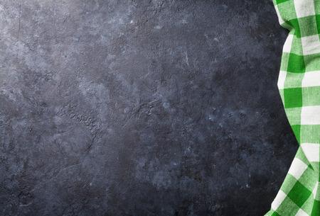 Foto de Towel over stone kitchen cooking table. Top view with copy space - Imagen libre de derechos