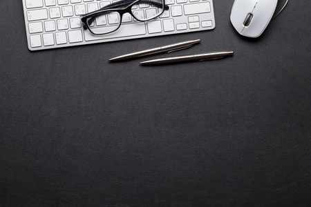 Photo for Office leather desk table with pc, glasses, pencil and pen. Top view with copy space - Royalty Free Image