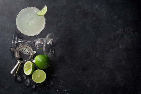 Photo for Margarita cocktail on dark stone table. Top view with space for your text - Royalty Free Image