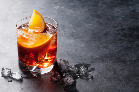 Photo pour Negroni cocktail on dark stone table. With space for your text - image libre de droit