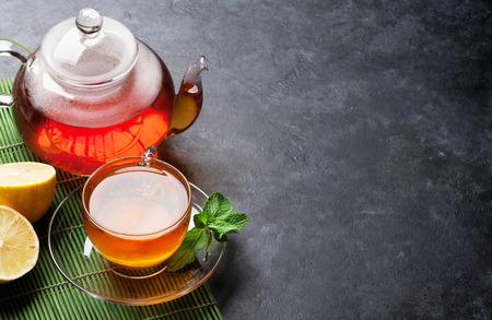 Photo pour Tea cup and teapot on stone table. View with copy space - image libre de droit