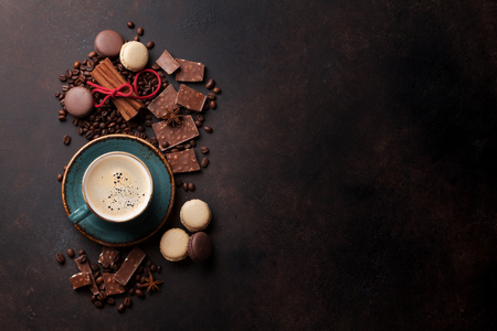 Photo for Coffee cup, beans, chocolate and macaroons on old kitchen table. Top view with copyspace for your text - Royalty Free Image