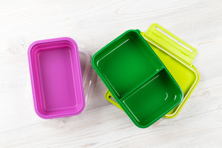Photo for Empty lunch boxes on wooden table. Top view - Royalty Free Image