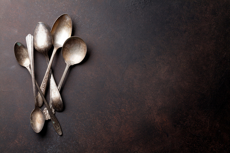 Photo pour Old vintage spoons on stone table.Top view with copy space - image libre de droit