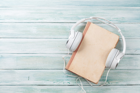 Photo for Audio book concept. Headphones and old book over wooden table. Top view with space for your text - Royalty Free Image