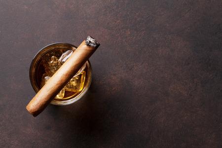 Foto de Whiskey with ice and cigar. Top view with copy space - Imagen libre de derechos