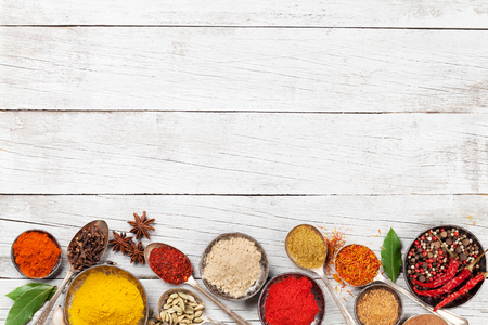 Photo pour Various spices and herbs on wooden table. Top view with space for your text - image libre de droit