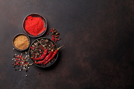 Photo for Colorful pepper. Various spices and herbs on stone table. Top view with space for your text - Royalty Free Image